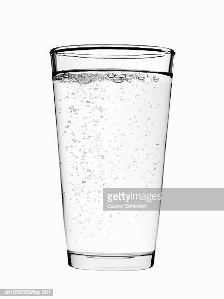 Glass of sparkling water on white background