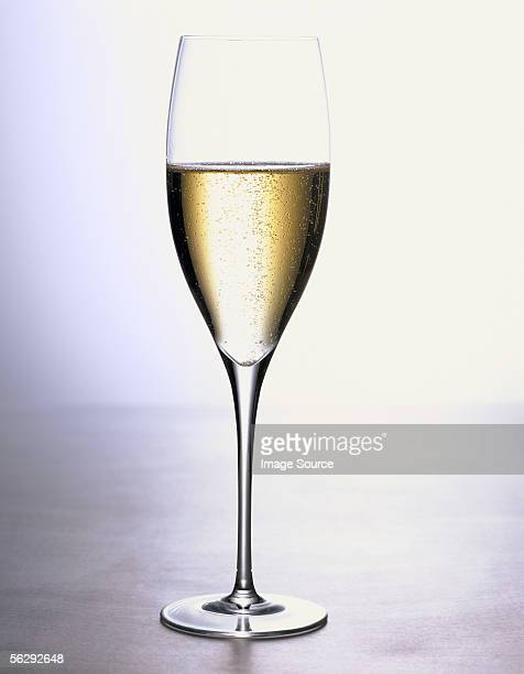 glass of sparkling wine - champagne flute stock pictures, royalty-free photos & images