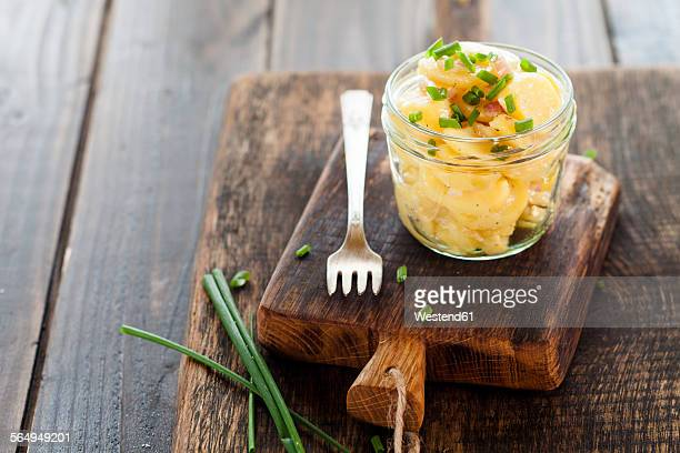 Glass of Swabian potato salad on wooden board