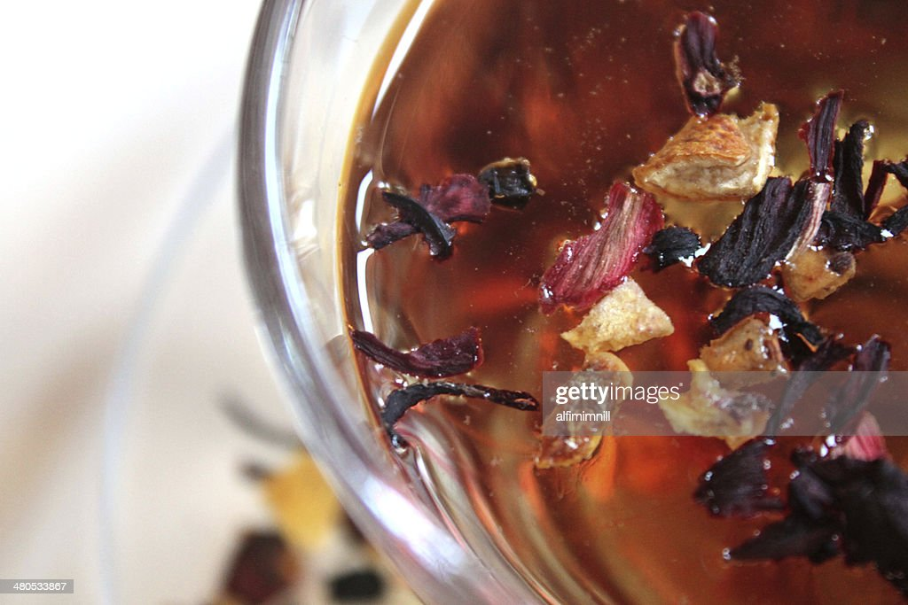 Glass of tea in rosehip leaves and dried fruits : Stock Photo