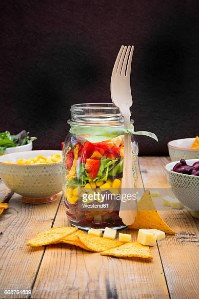 glass of tex-mex salad and ingredients on wood - jars with salad stock pictures, royalty-free photos & images