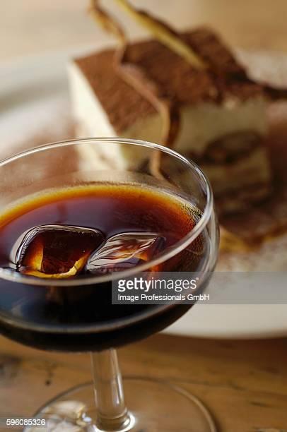 A glass of Tia Maria (coffee liqueur) and tiramisu