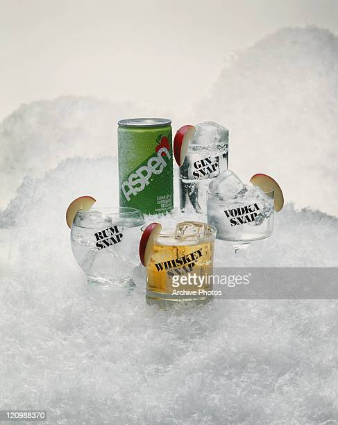 Glass of tin can and drink glass on crushed ice