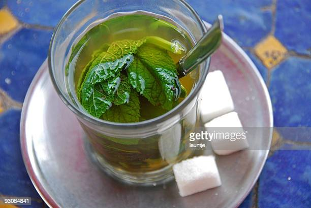 Glass of traditional Mint Tea with sugar
