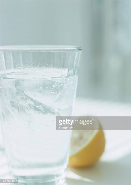 A glass of water and halved lemon