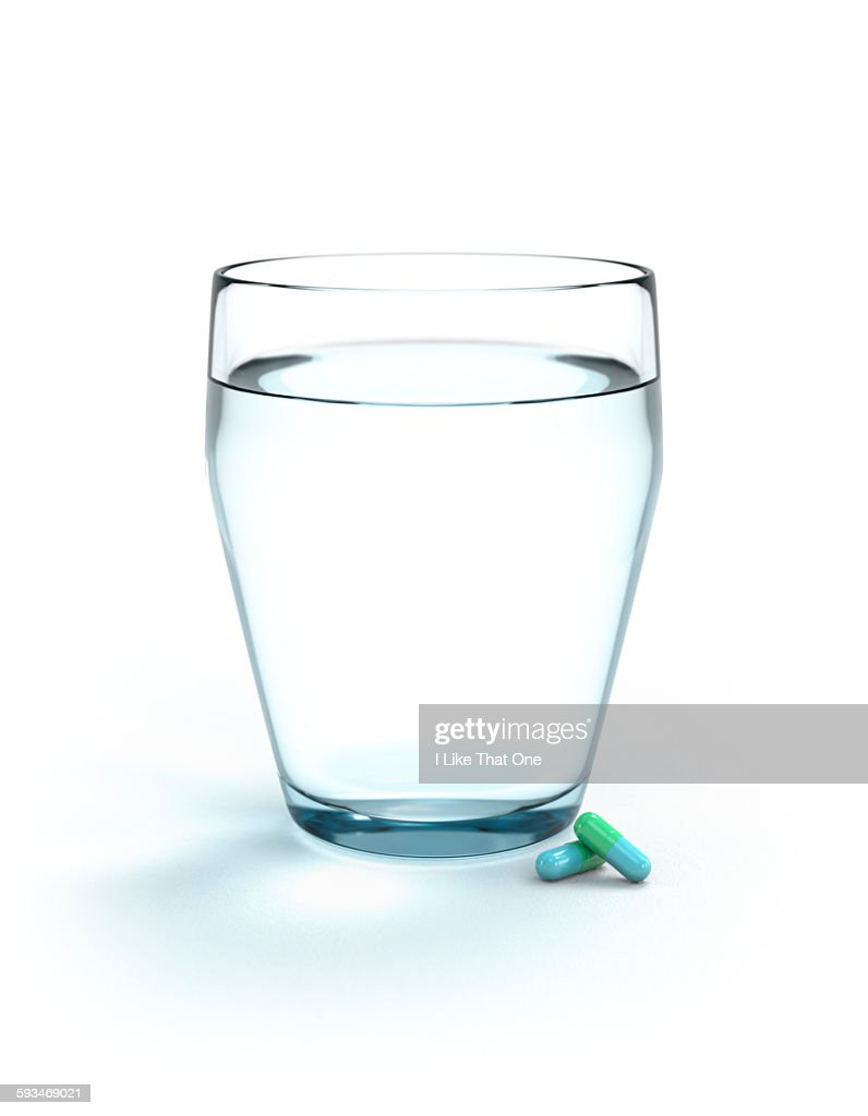 Glass of water and two pills / medication : Stock Photo