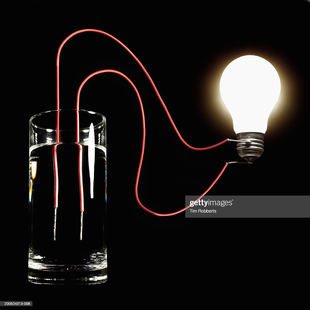 Light Bulb Wallpaper: Glass Of Water Hooked Up To Light Bulb Black Background