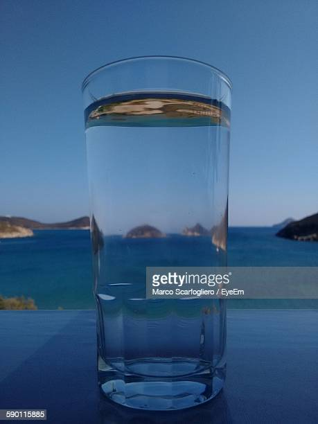 Glass Of Water On Table At Seaside