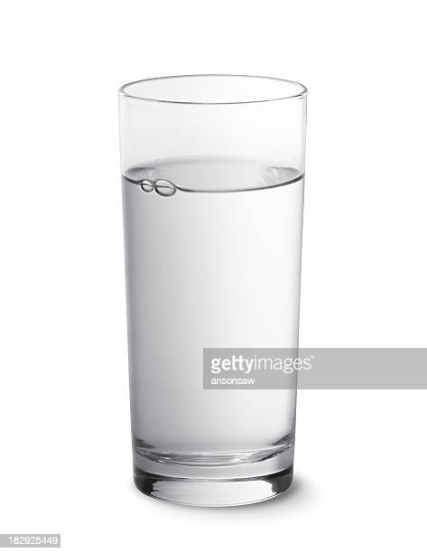 glass of water photographed against a white background - drinking glass stock pictures, royalty-free photos & images