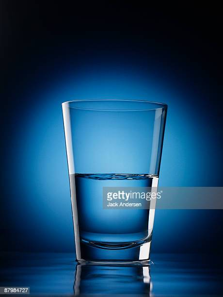 glass of water - half full stock pictures, royalty-free photos & images