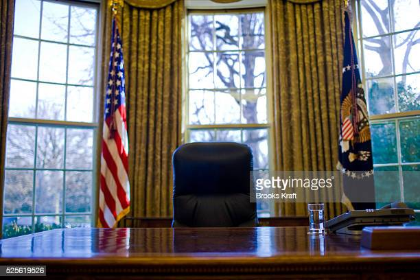 A glass of water sits on President Barack Obama's desk in the Oval Office at the White House in Washington