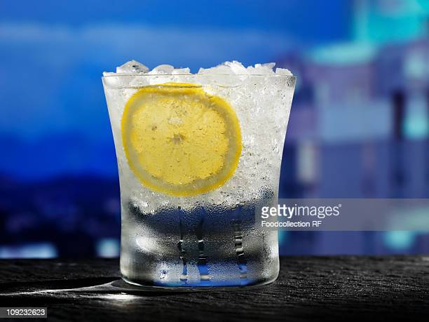 Glass of water with crushed ice and slice of lemon, close-up