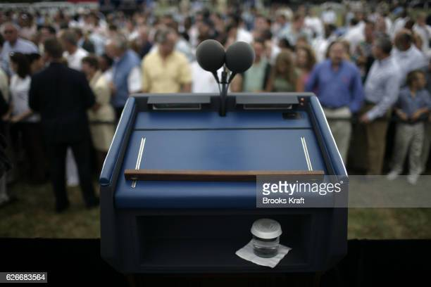 A glass of water with the Presidential seal sits under President Bush's podium at a maritime training institute in Piney Point Maryland