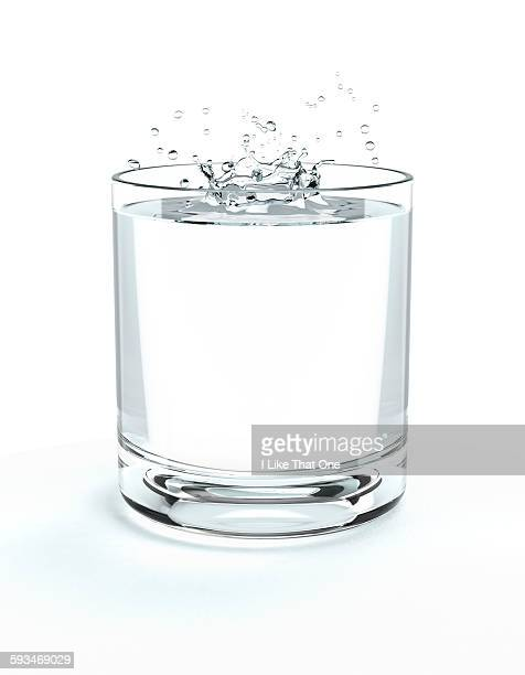 Glass of water with water splash on surface