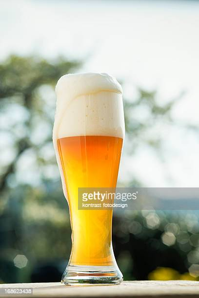 Glass of wheat beer in a Biergarden Weizenbier Hefeweizen