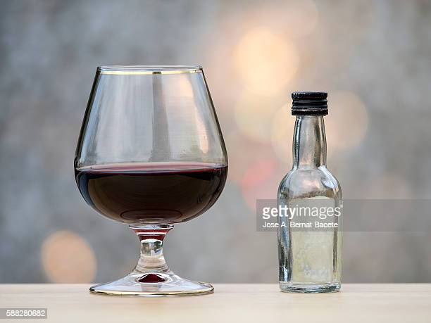 Glass of whiskey and bottle Glass of whiskey and bottle mini bar with natural light with natural light