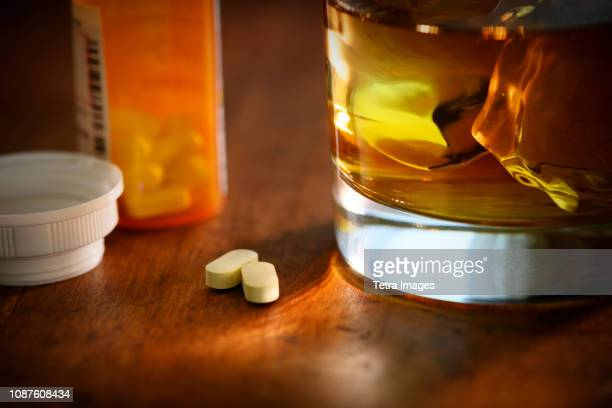 glass of whiskey and oxycodone - oxycodone stock pictures, royalty-free photos & images