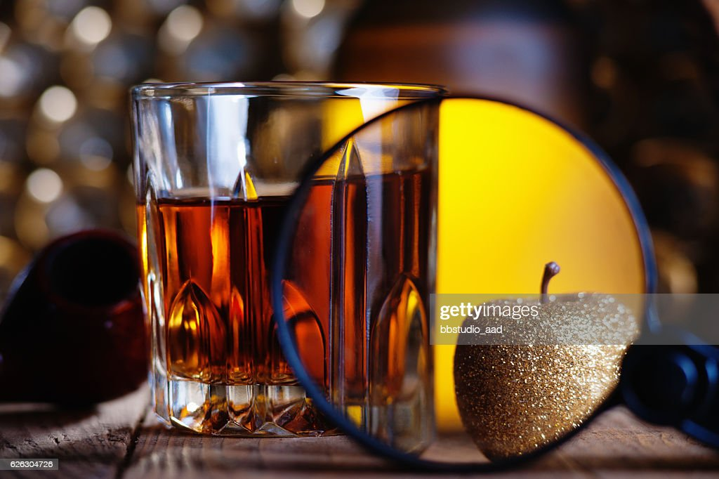 Glass Of Whiskey Magnifying Glass Golden Apple And Smooking Pipe