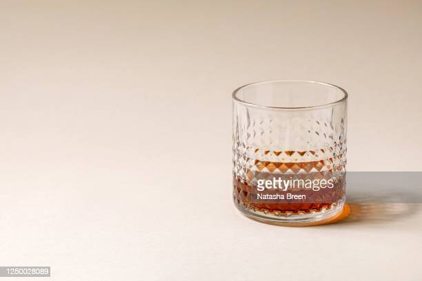 glass of whisky - bourbon whiskey stock pictures, royalty-free photos & images