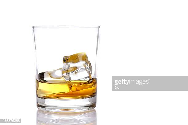 glass of whisky - liqueur stock pictures, royalty-free photos & images