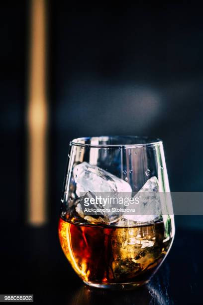 a glass of whisky with ice. - rum stock pictures, royalty-free photos & images
