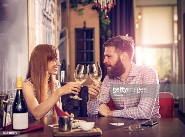 glass of white wine before dinner - anniversary stock pictures, royalty-free photos & images