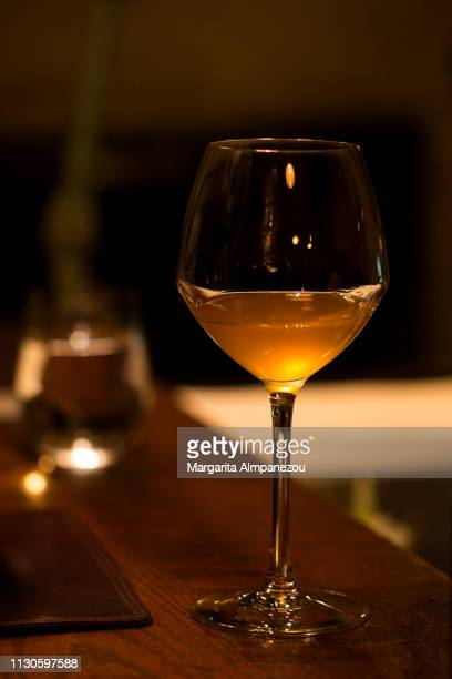 Glass of white wine on a premium wooden bar surface