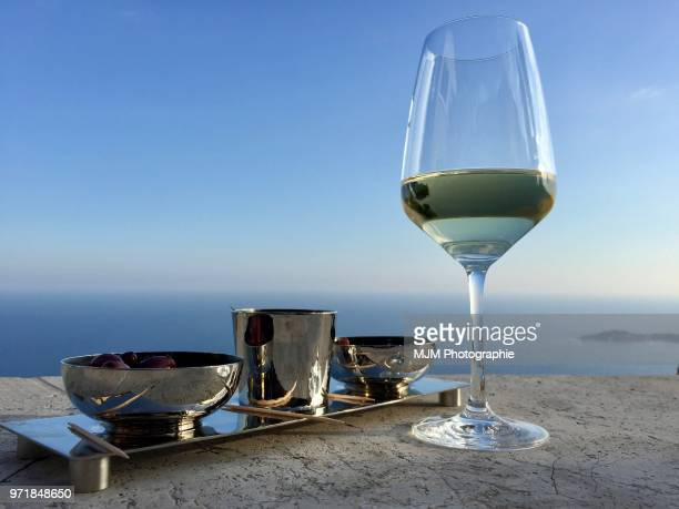 Glass of white wine overlooking the Mediterranean Sea