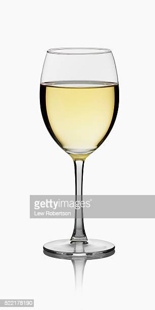 glass of white wine - drinking glass stock pictures, royalty-free photos & images