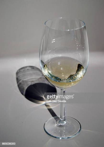 glass of white wine - refresco stock photos and pictures