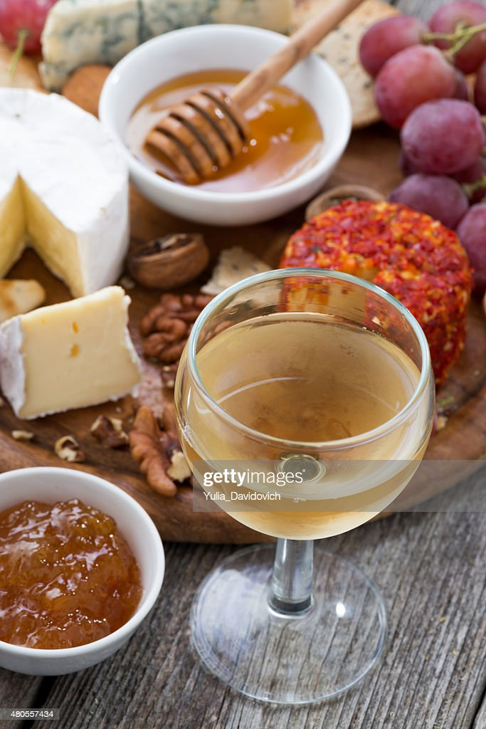 glass of white wine, snacks on wooden table, top view : Stock Photo