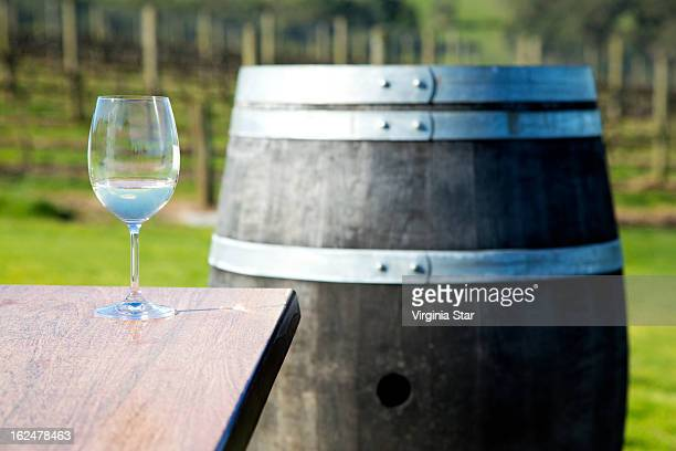 Glass of wine and a wine barrel