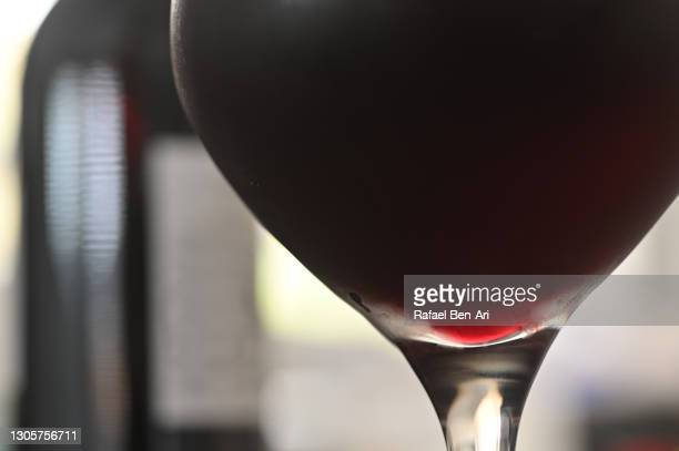 glass of wine and bottle background - rafael ben ari stock pictures, royalty-free photos & images