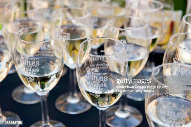 Glass of wine are set out for guests at the 4th Annual Kaleidoscope Wines and Wishes event in Mission Viejo Proceeds from the event will benefit...
