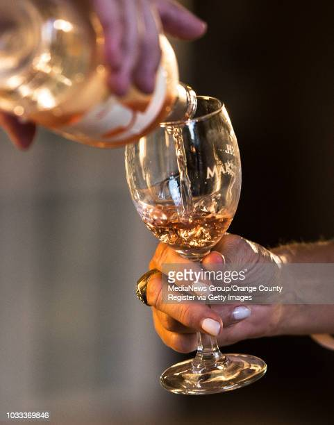 A glass of wine is poured at the 4th Annual Kaleidoscope Wines and Wishes event in Mission Viejo Proceeds from the event will benefit MakeAWish...