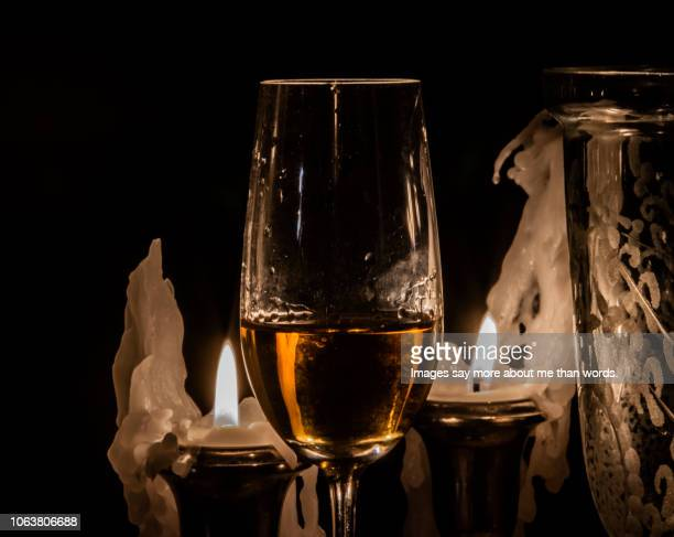 a glass of wine surrounded by candles. still life. - brazilian waxing stock photos and pictures