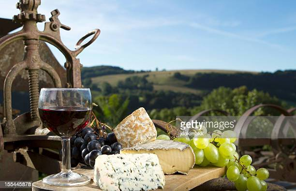 Glass of wine with a selection of cheese