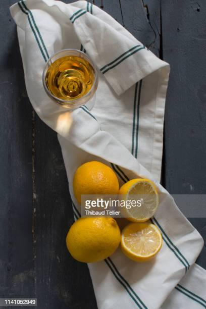 glass of wine with lemon - dish towel stock pictures, royalty-free photos & images