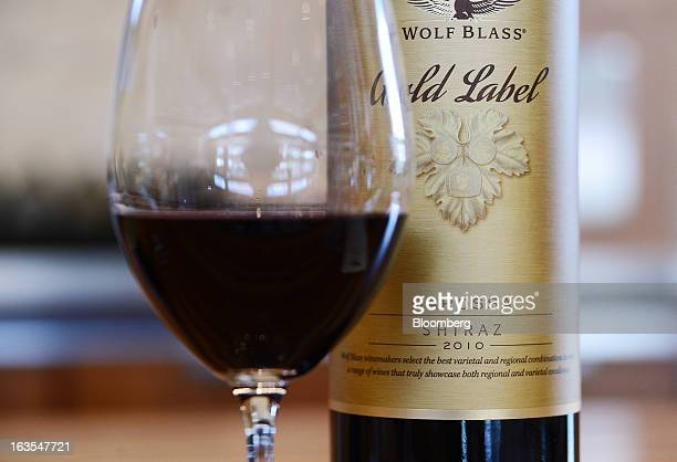 A glass of Wolf Blass Shiraz wine is arranged for a photograph at the tasting bar at Treasury Wine Estates Ltd's Wolf Blass winery in the Barossa...