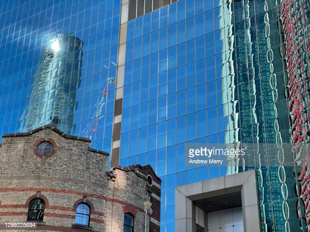 glass office block and old brick historic building facade, sydney, australia - darling harbour stock pictures, royalty-free photos & images