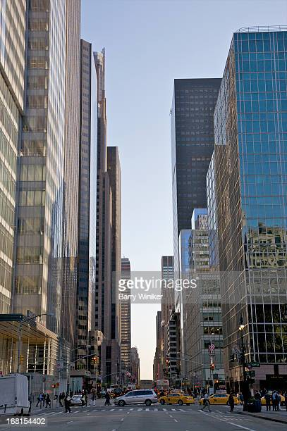 glass office buildings surrounding blue sky. - sixth avenue stock pictures, royalty-free photos & images