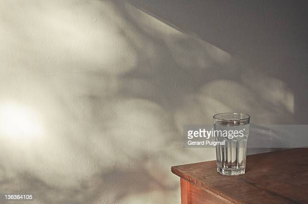 glass on table - next to stock pictures, royalty-free photos & images