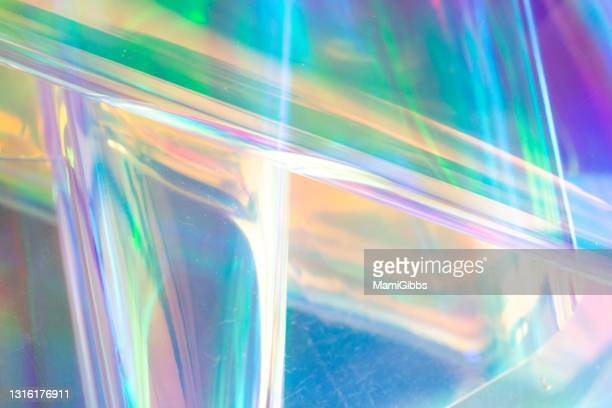 glass on the hologram rainbow color cloth - shiny stock pictures, royalty-free photos & images