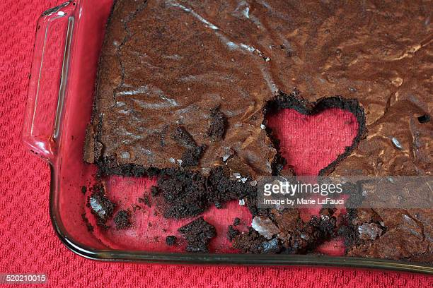 glass pan chocolate brownies with heart-shape - marie lafauci stock pictures, royalty-free photos & images