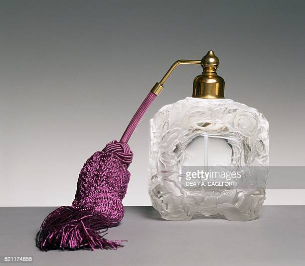 Glass perfume spray bottle on a square base with sandblasted rose reliefs and bevelled mirrored sides and legs 19301935 20th century Unspecified