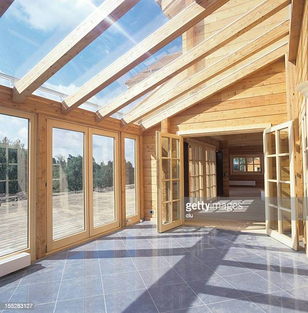 Glass roof of wooden house