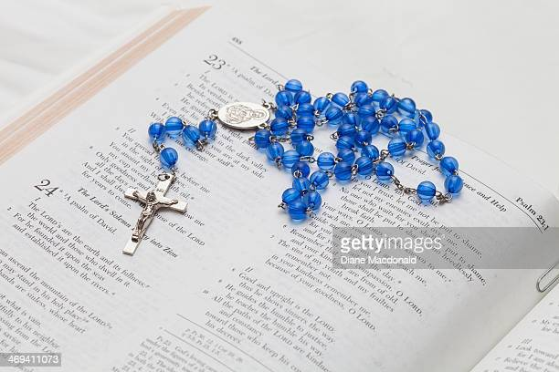 Glass Rosary Beads on Open Bible