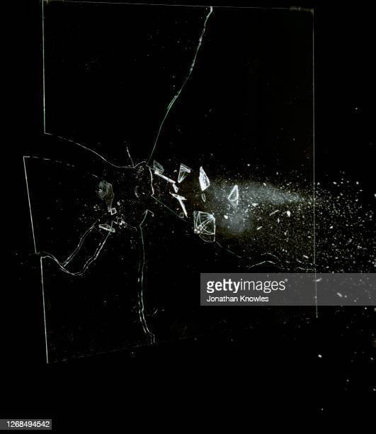 glass shattering - crime stock pictures, royalty-free photos & images