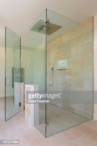 Glass shower with open glass door stock photo getty images planetlyrics Image collections