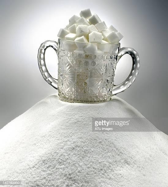 Glass sugar bowl on sugar pile